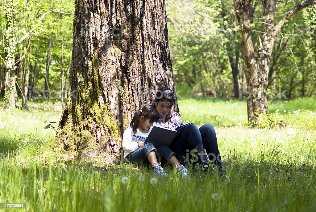 Reading book together stock photo