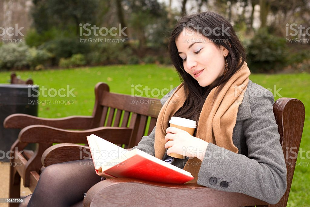 reading book with a coffee royalty-free stock photo