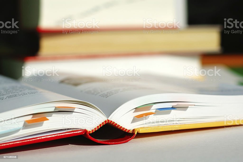 Reading book with bookmarks stock photo