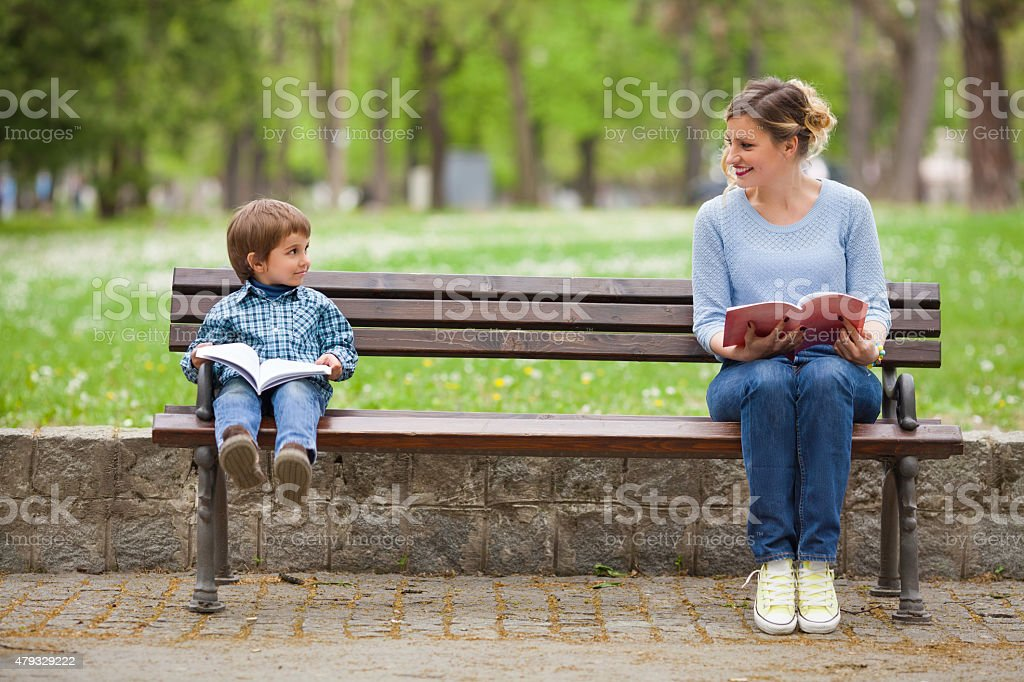 Reading Books in a Park stock photo