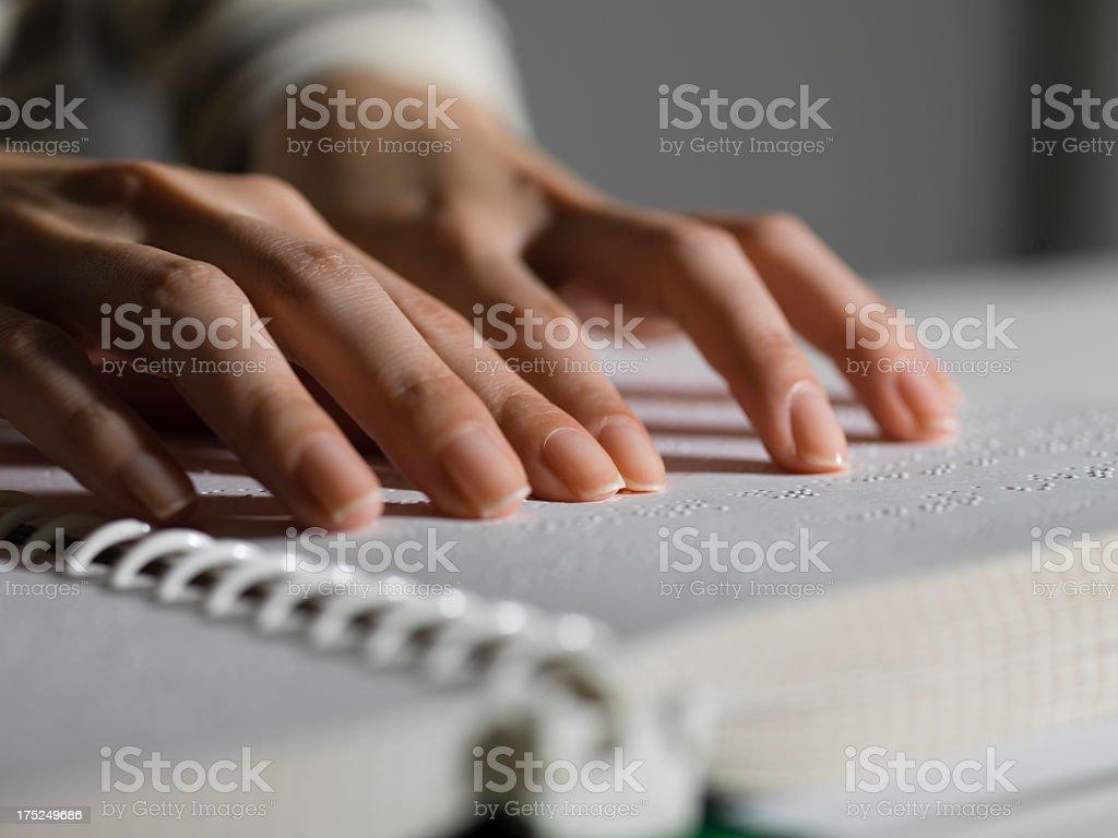 Reading Braille stock photo