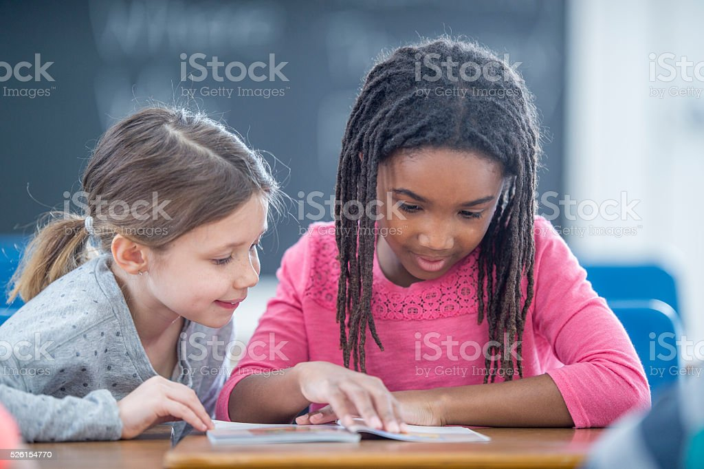Reading Buddies at School stock photo