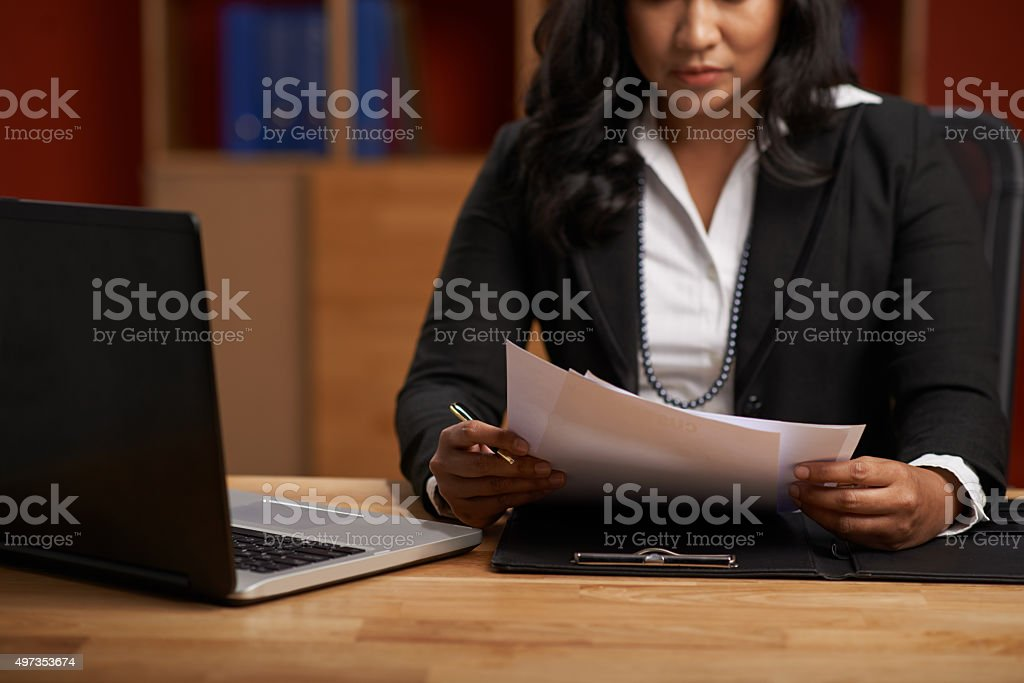 Reading business contract stock photo