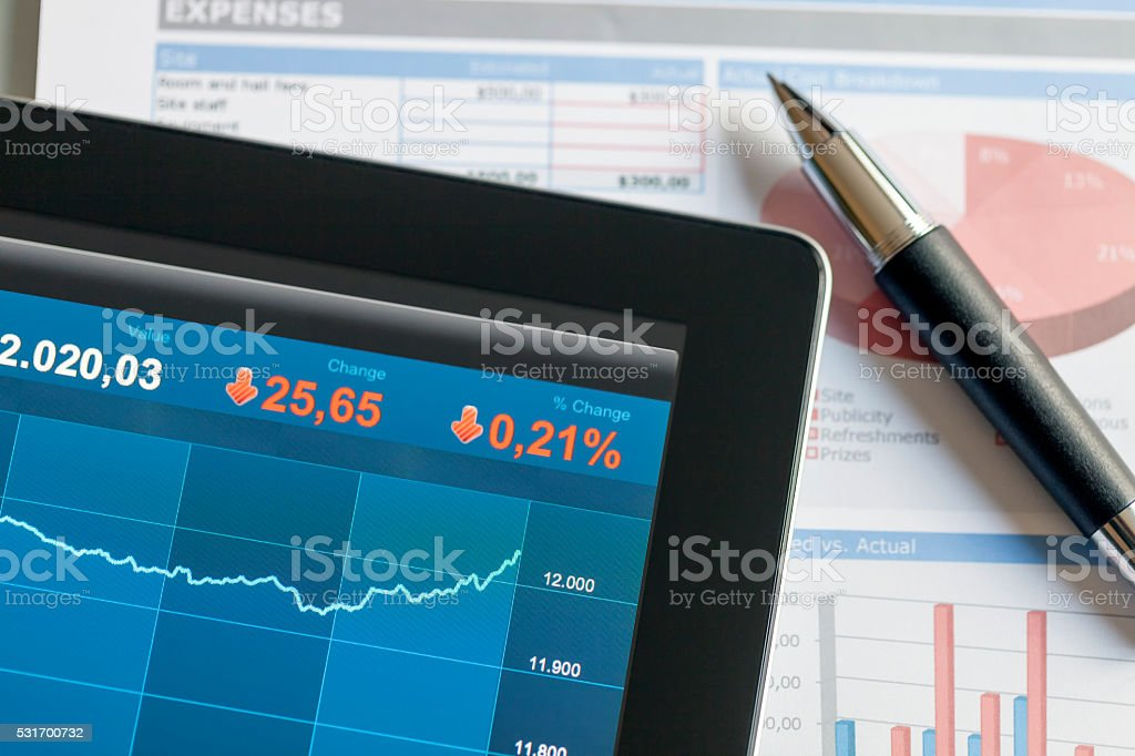 Reading Business Market on a Digital Tablet Screen stock photo