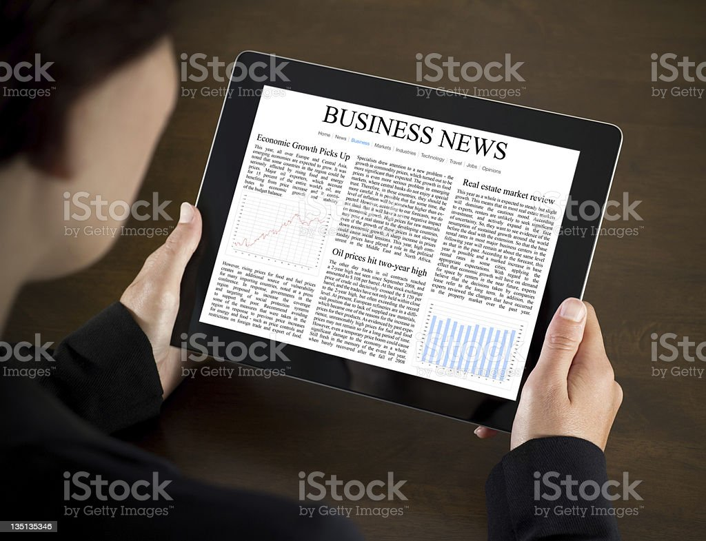 Reading Business News on Tablet PC royalty-free stock photo