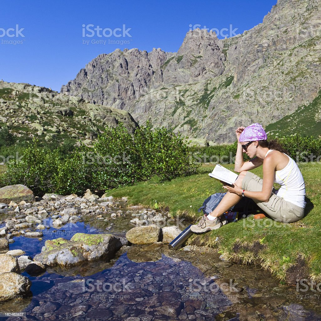 reading by the brook royalty-free stock photo
