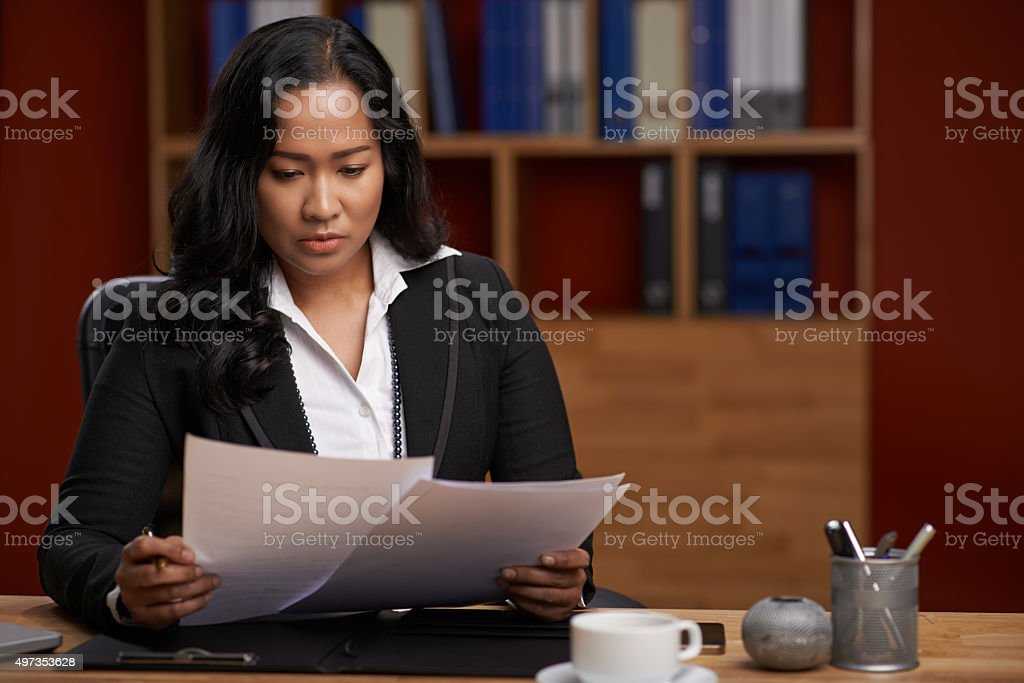 Reading documents stock photo