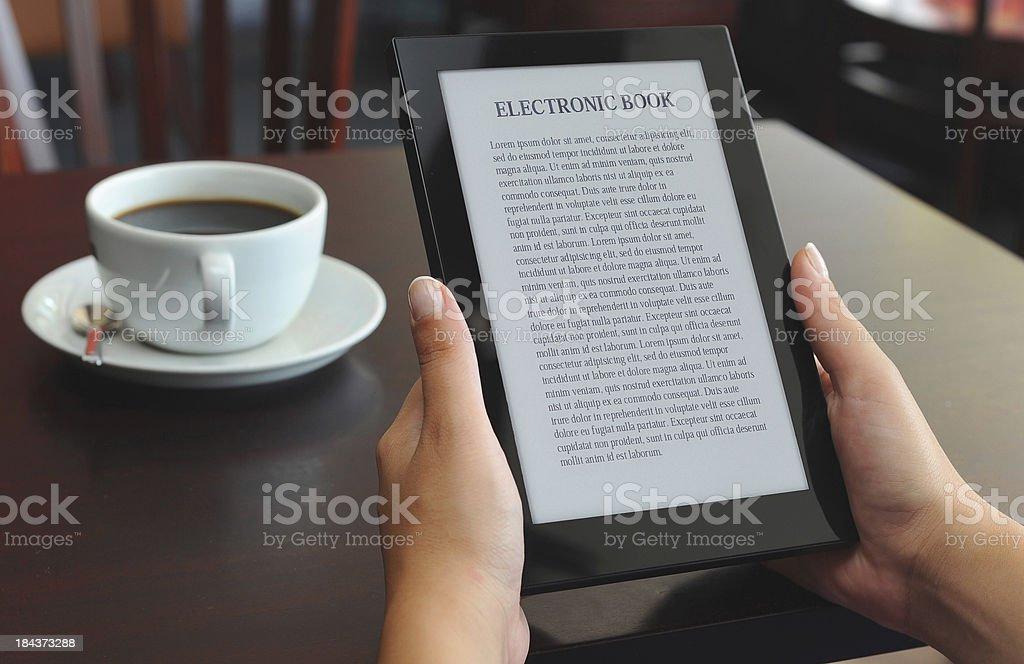 reading E-book on e-reader stock photo