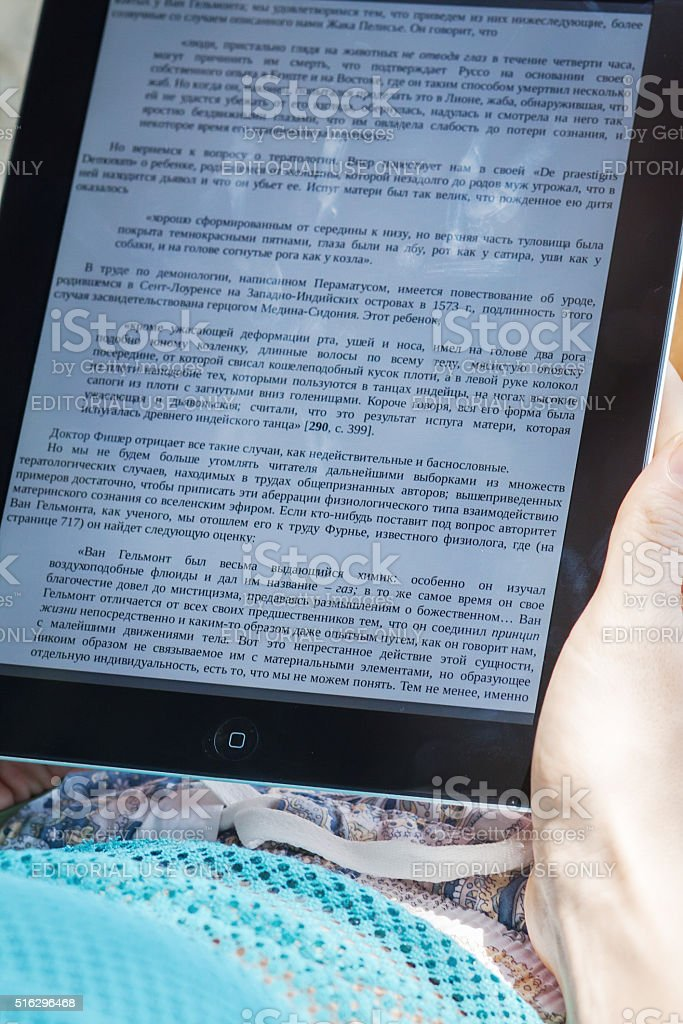 Reading E-book on iPad stock photo