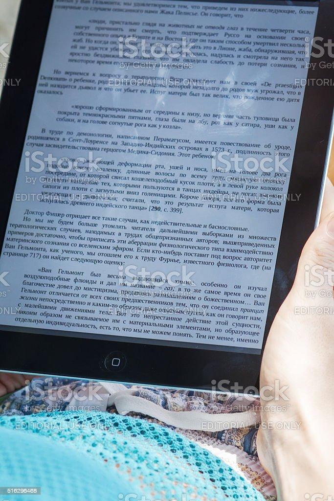 Reading E-book on iPad stock photo