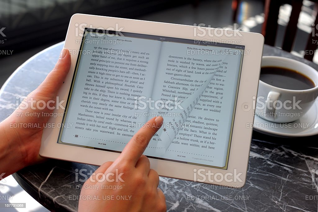 Reading E-book with iPad 3 stock photo