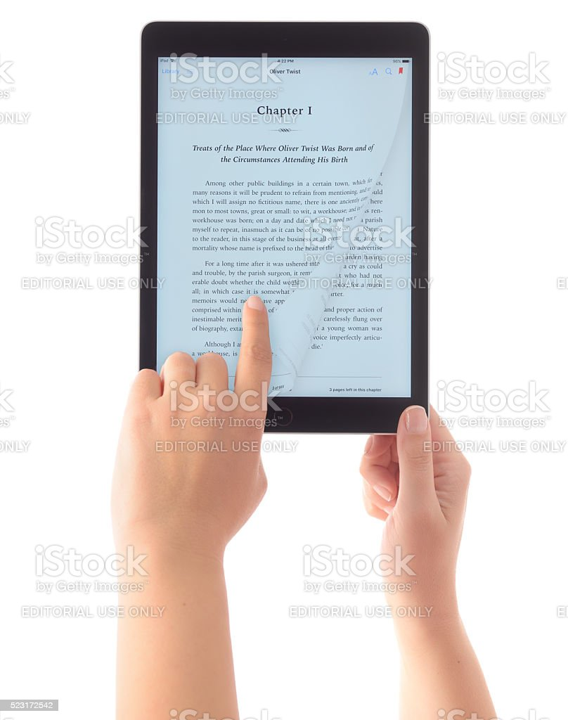Reading e-book with iPad Air 2 stock photo