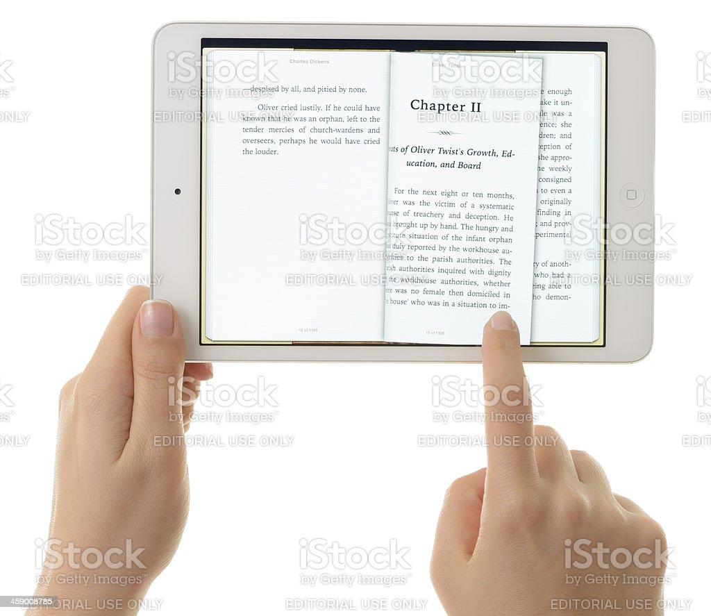 Reading e-book with iPad Mini stock photo