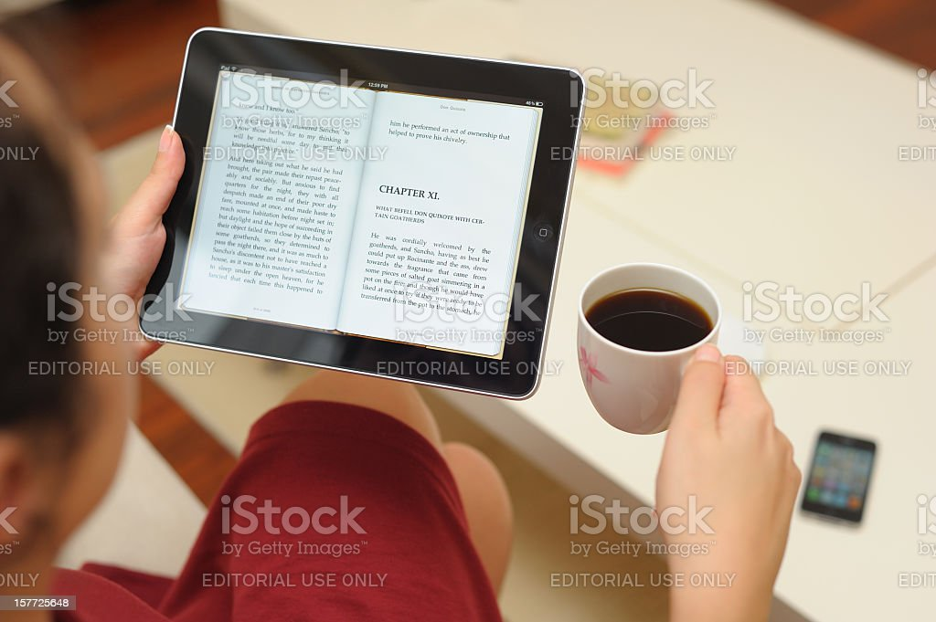 Reading E-book with iPad stock photo