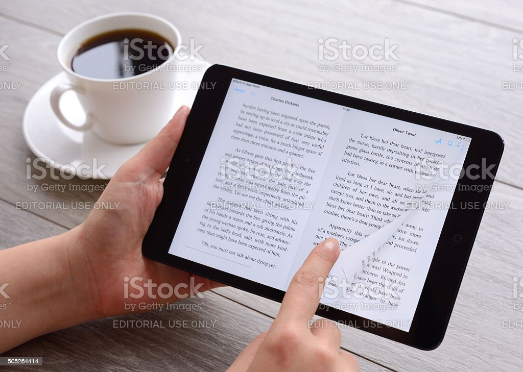 Reading e-book with iPad tablet pc stock photo