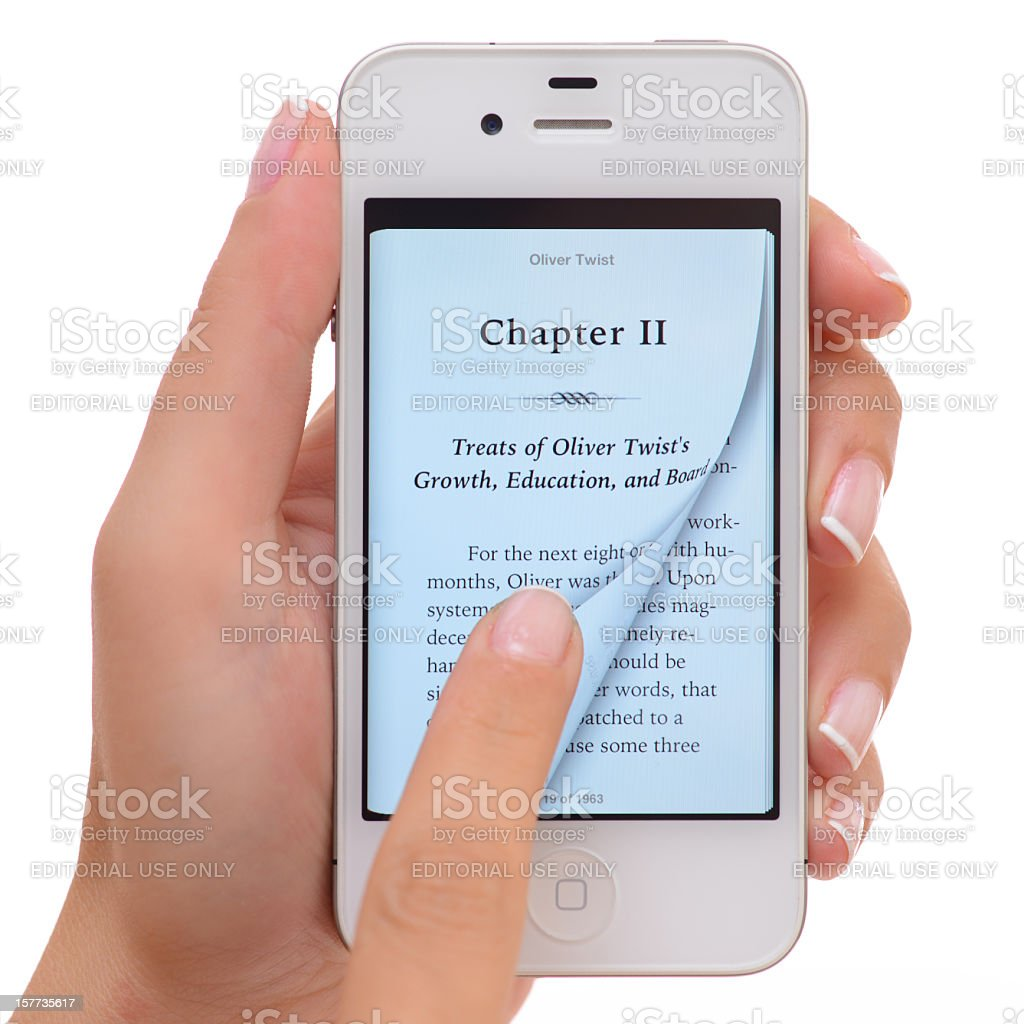 Reading e-book with iPhone stock photo