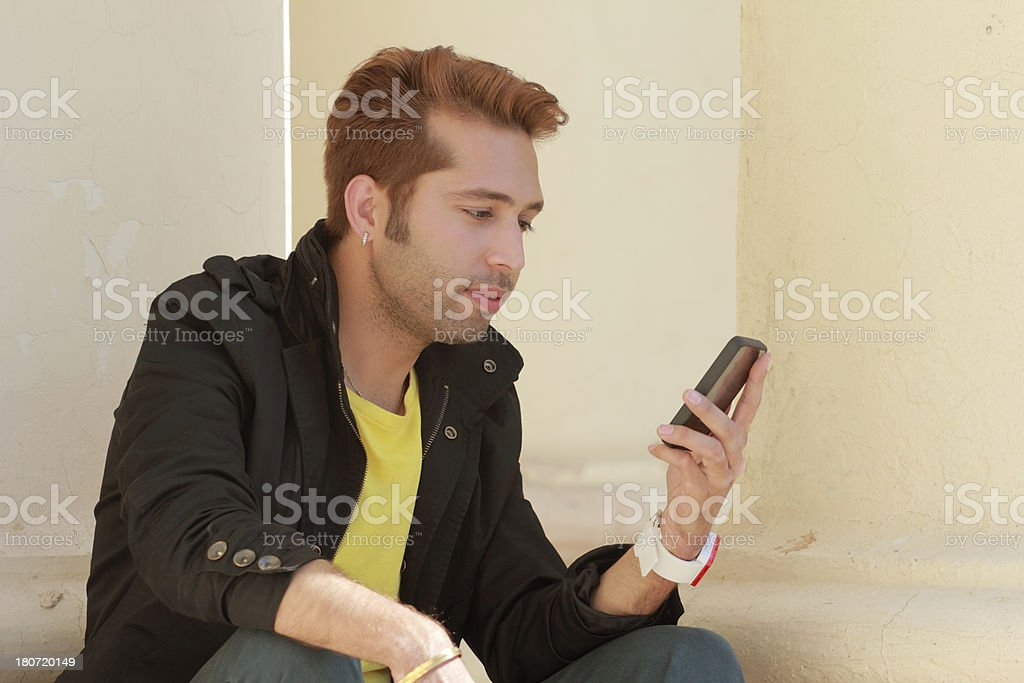 Reading Email On A Cell Phone royalty-free stock photo