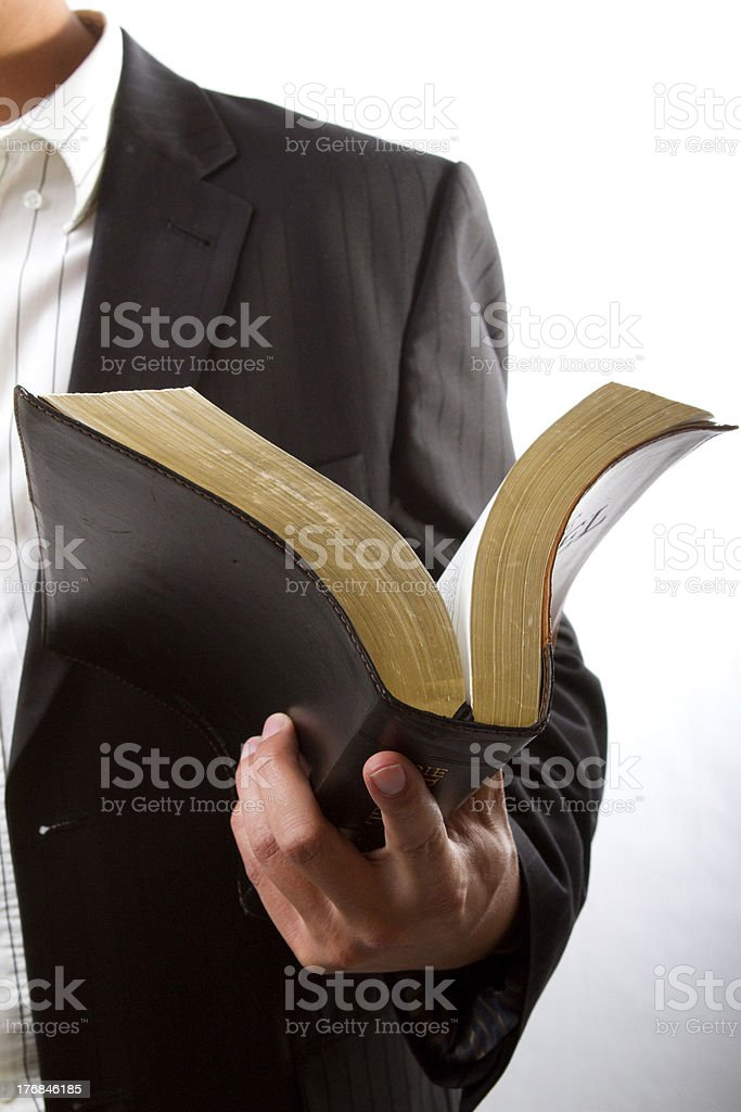 Reading from the Bible stock photo