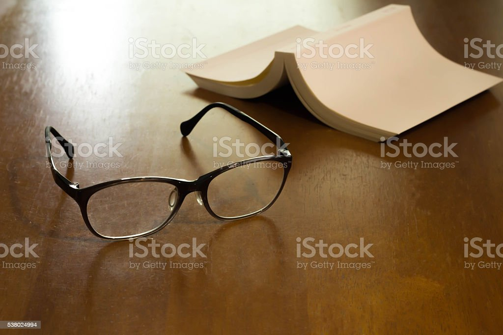 Reading glasses and a book stock photo