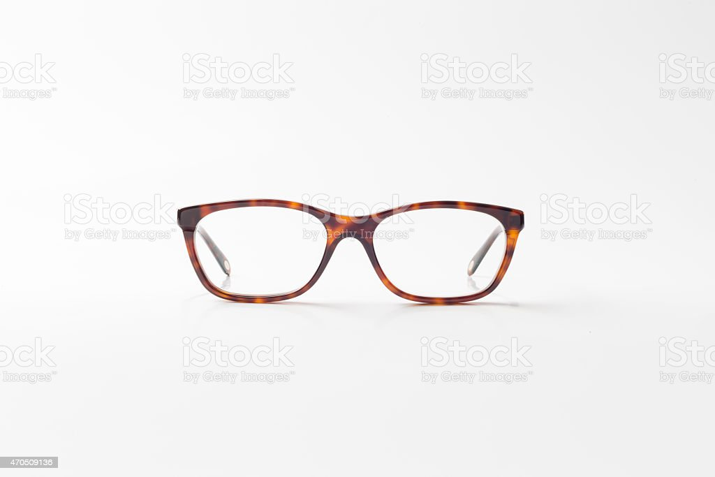 Reading Glasses facing the camera on the white background stock photo