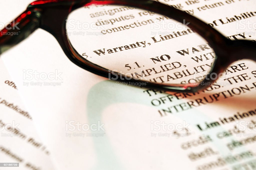 Reading glasses on a contract with fine print stock photo