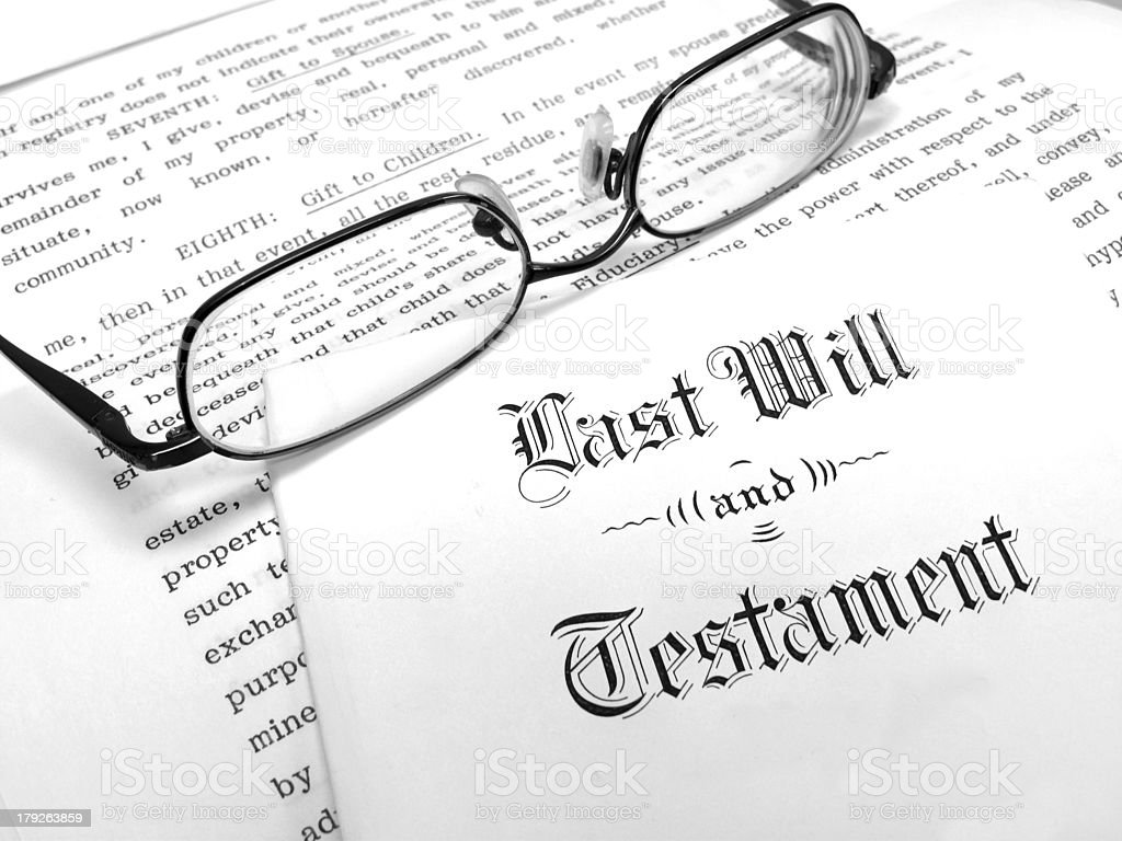 Reading glasses on envelope with last will stock photo