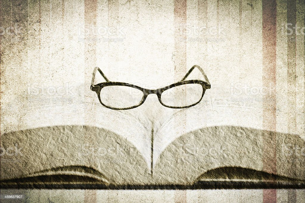 reading glasses on the book royalty-free stock photo