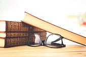 reading glasses with books on the table