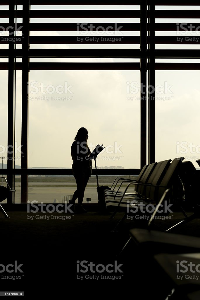 reading in airport royalty-free stock photo
