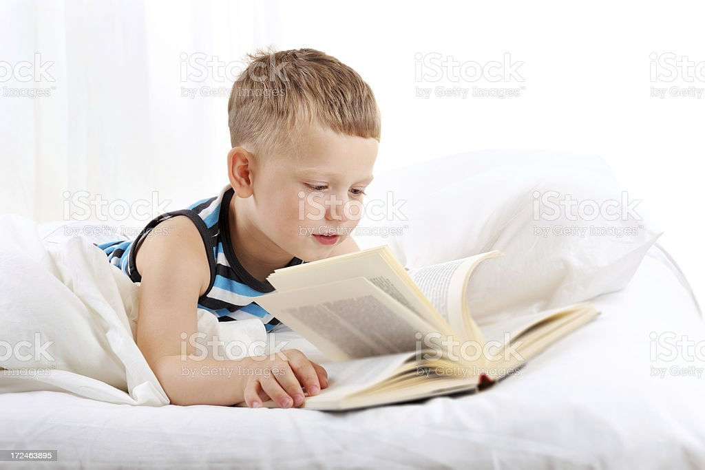 Reading in bed royalty-free stock photo