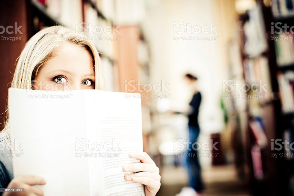 Reading in library royalty-free stock photo