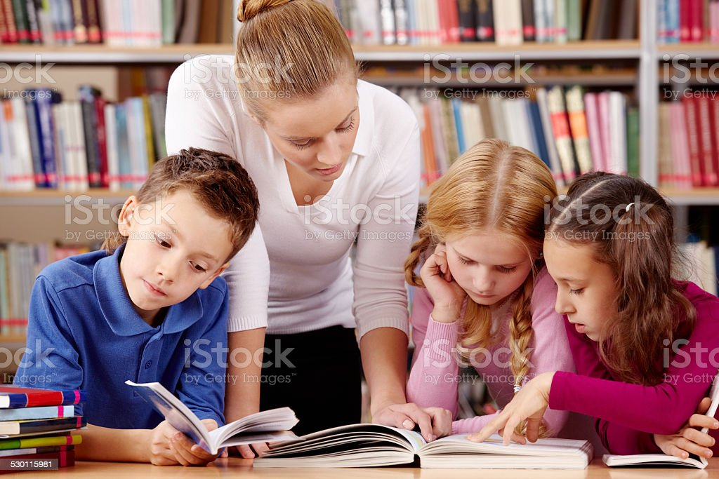 Reading in library stock photo