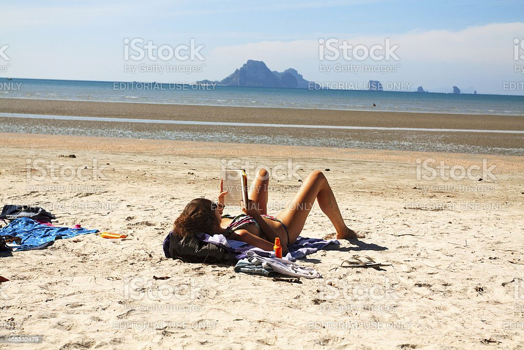 Reading in sun at Thailand's beach royalty-free stock photo