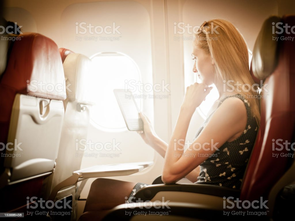 Reading in the airplane royalty-free stock photo