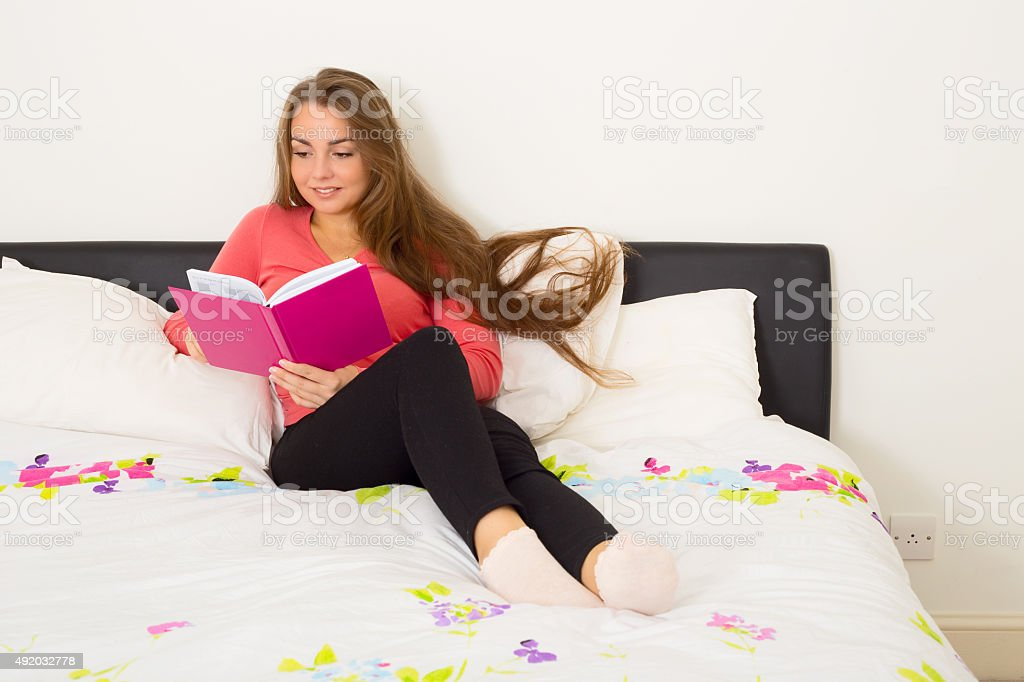 reading in the bedroom royalty-free stock photo