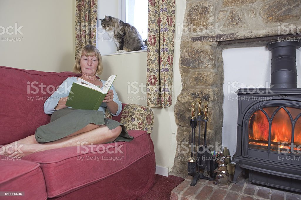 Reading In The Cottage On A Sunday Afternoon stock photo