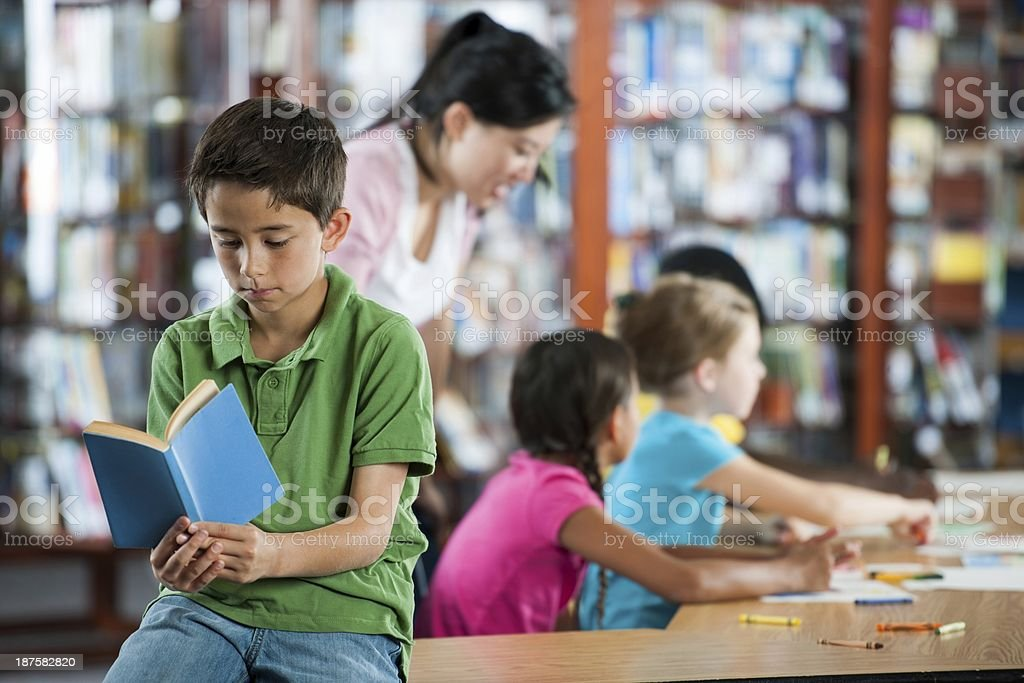 Reading in the library royalty-free stock photo