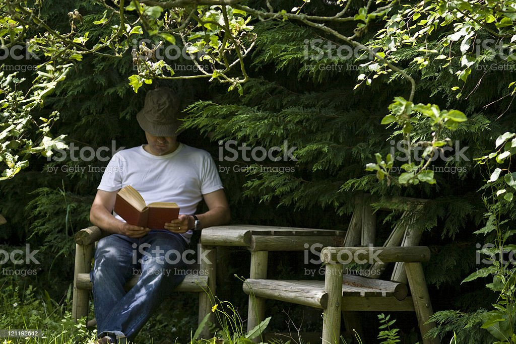 Reading in the shade royalty-free stock photo