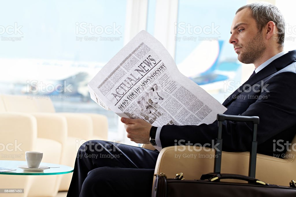 Reading in waiting room stock photo