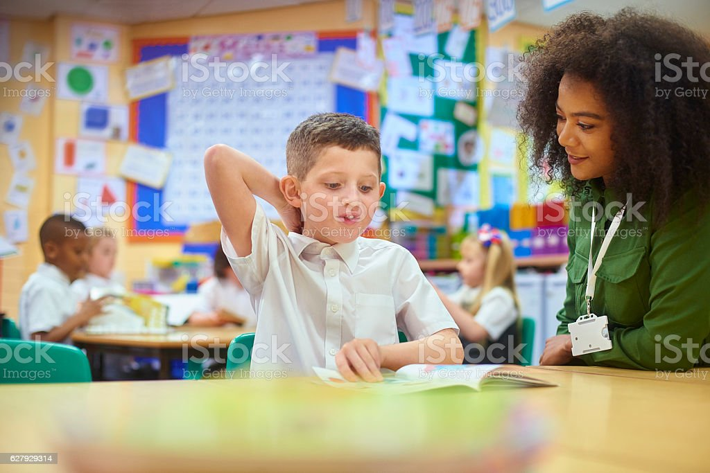 reading intervention in class stock photo