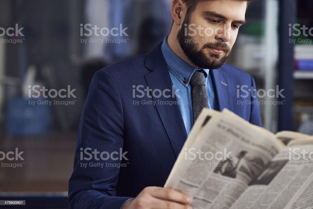 Reading latest news stock photo