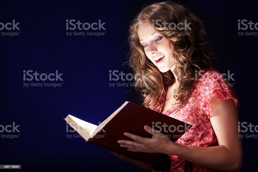 Reading magic book stock photo