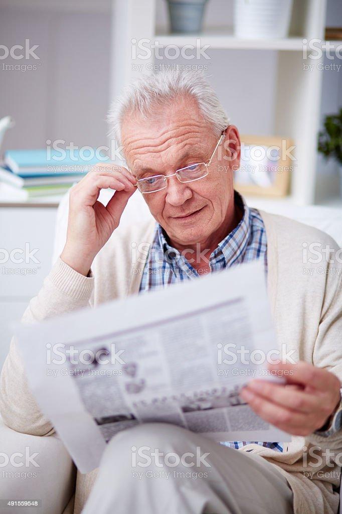 Reading morning newspaper stock photo