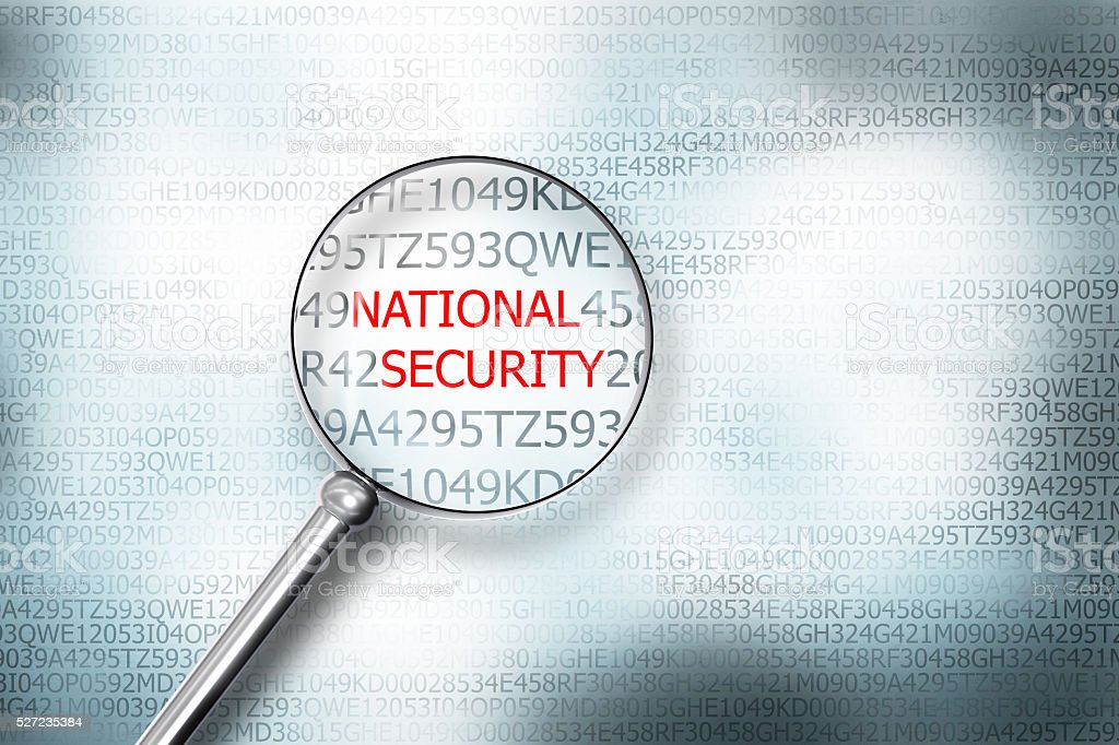 reading national security on digital computer screen with a magn stock photo