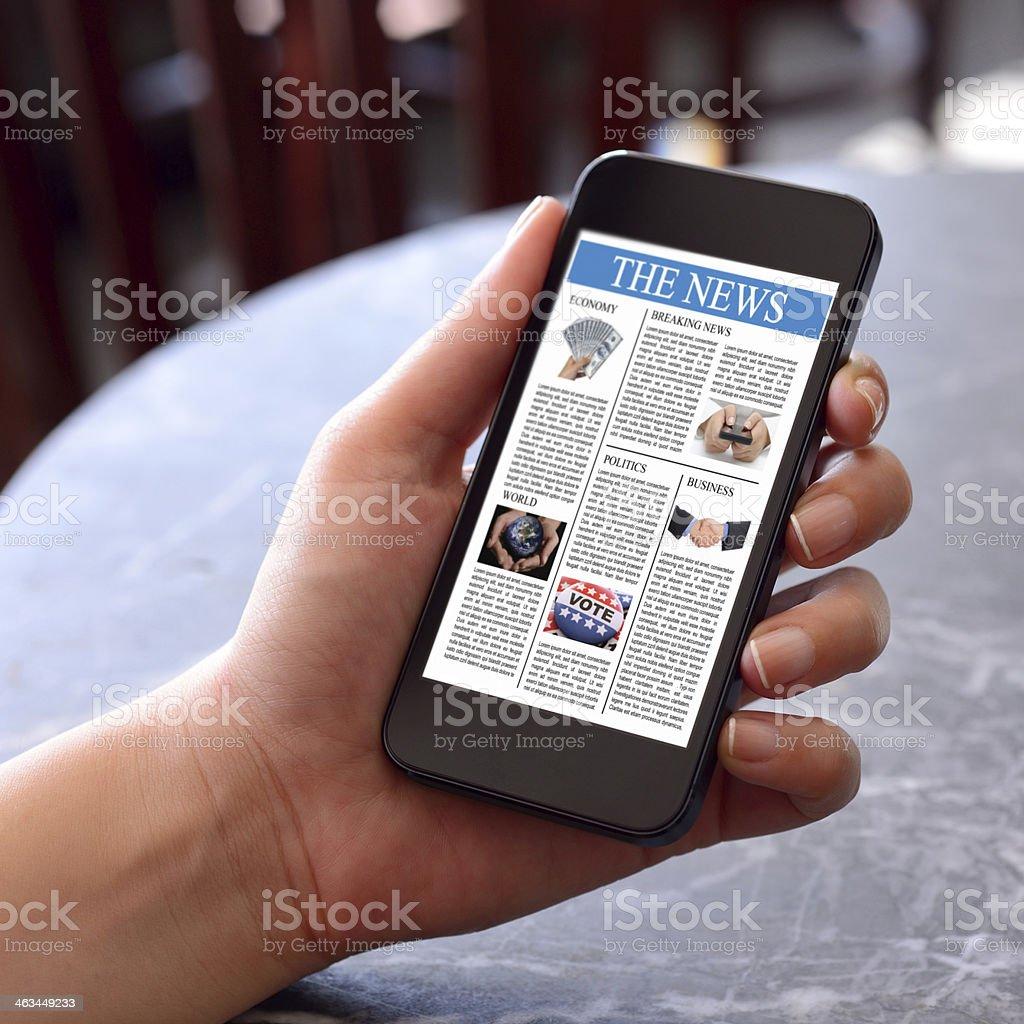 Reading new on smart phone stock photo