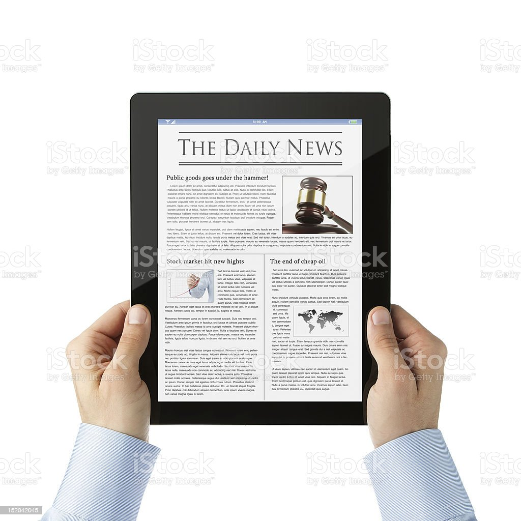 Reading news at digital tablet stock photo