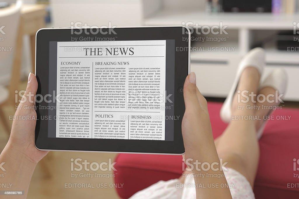 Reading news on iPad royalty-free stock photo