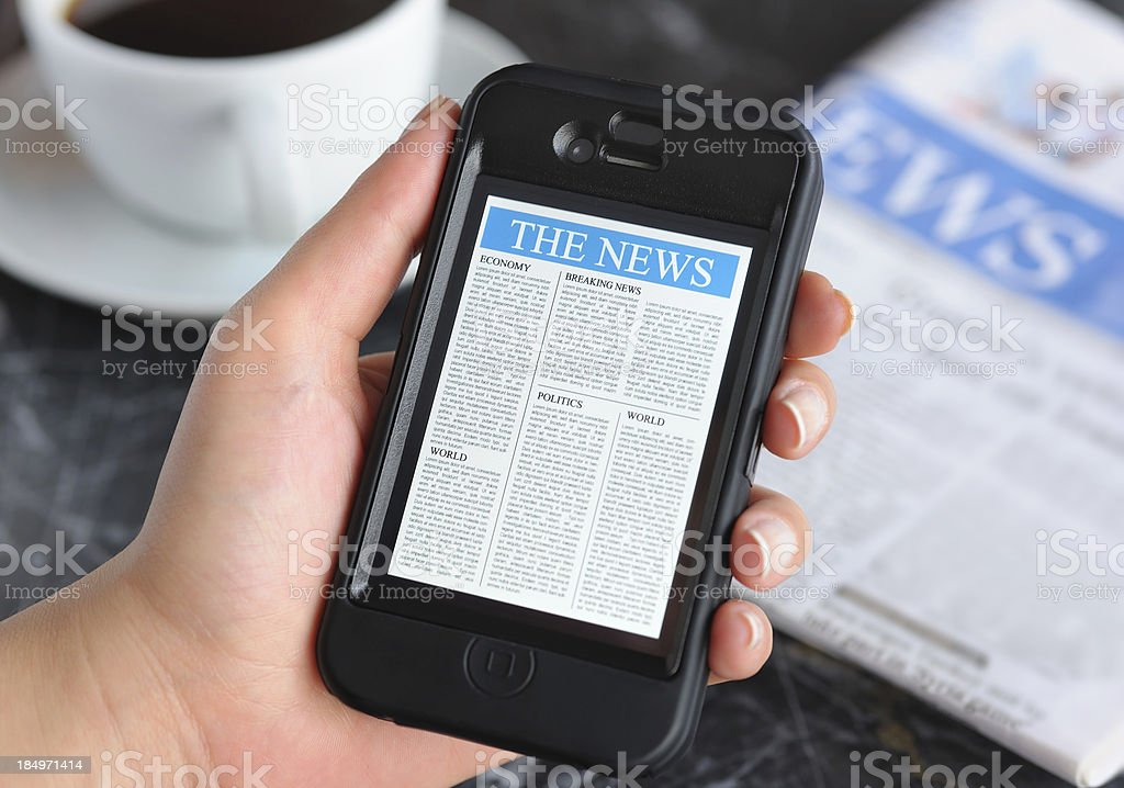Reading news on smart phone royalty-free stock photo
