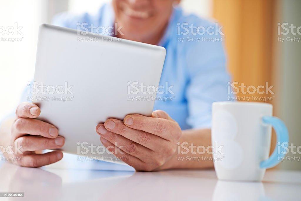 Reading news online stock photo