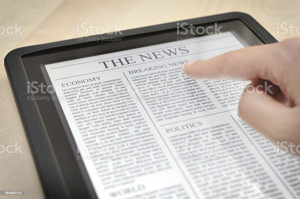 Reading news with digital tablet stock photo